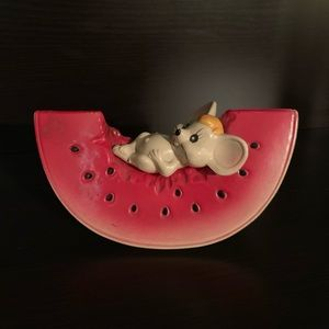 Mouse on a watermelon bank